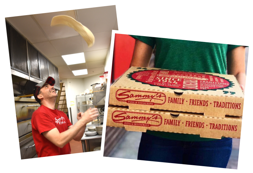man tossing dough, and some pizza boxes